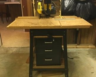 """Rockwell 12"""" woodworking Radial saw with table, storage, books, and other accessories."""