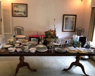 """96"""" Transitional inlay dining room table.  Hand-painted plates,  teacups, and saucers, crystal, bowls, candy dish, serving dishes."""