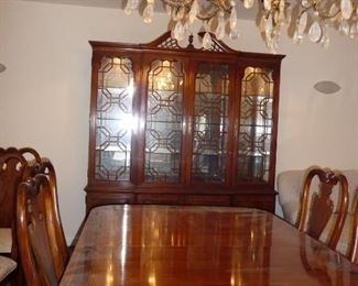 Thomasville dining set includes table with leaves, custom pads, 12 chairs, and china cabinet.