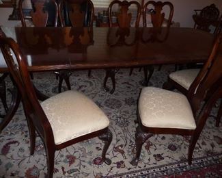 dining set includes 12 chairs (2 arm chairs)