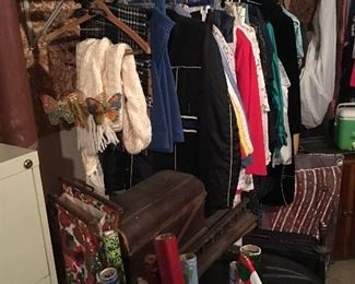 Clothes, antique sewing machine, wicker baskets and wrapping paper