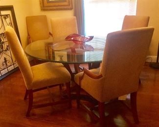 Glass top dining table and upholstered chairs