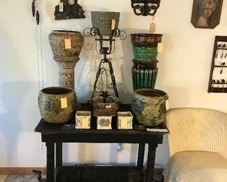 American Art Pottery Collection ~ Weller Majolica Jardiniere And Pedestal. Monmouth Stoneware Egyptian Revival Jardiniere And Pedestal, Roseville  Imperial Jardinieres ~ Two Available, Roseville Roma & Roma Cameo Planters, Brush Planter With Rose And Ivy Pattern, Old Wrought Iron Plant Stand, Old Weather Black Painted Wooden Table