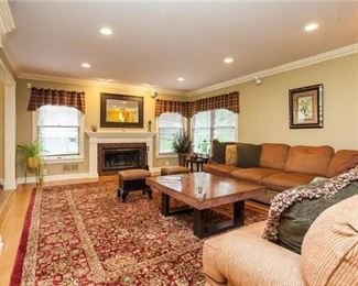 Family Room with coffee table that slides open. All furnishings are for sale