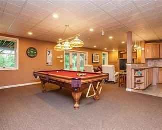 Beautiful wood pool table with intricate wood design