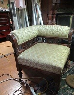 Upholstered corner chair.