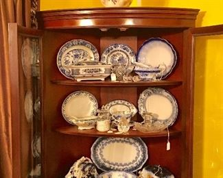 Mahogany corner cupboard filled with Flo-Blue china of all shapes