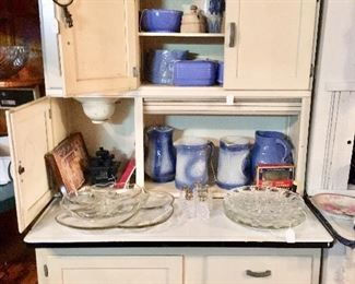 Hoosier cabinet filled with saltglaze pottery - late 19th and early 20th C.