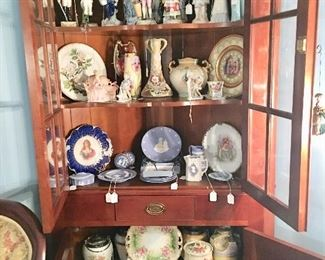 One of two Cherry corner cupboards filled with treasures - many handpainted and several 19th C.