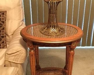 Wood with cane insets accent table.