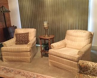 Matching upholstered club chairs.