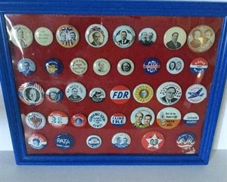 Framed collectible set of campaign buttons.