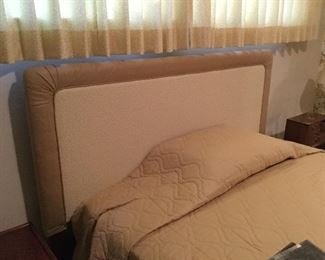 Upholstered padded headboard with bed frame. Can be either for full or queen mattress.