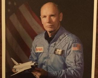 Official NASA photo of astronaut William Thornton with autograph
