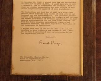 Letter from President Ronald Reagan to Congressman Charles Whitley with pen used to sign into law  The Agriculture and Food Act of 1981.
