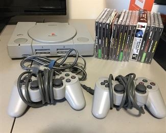 Play Station 1 with power cord, 2 controllers and about a dozen games (some never opened).