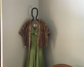 A mink stole sets off this green silk dress to a T.