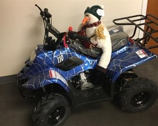 Frosty, the snowman, loves his ride. Both the youth's ATV and Frosty can be yours.