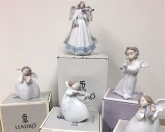All kinds of LLADRO angels playing musical instruments.