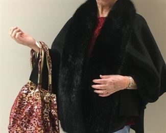 Maybe a shawl with a fur collar and a sparkly new bag may suit your needs.