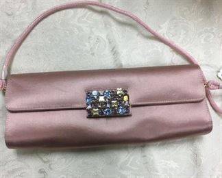 Delicate pink bag with a snazzy jeweled clasp.