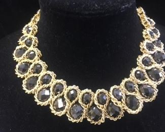 Golden collar with smoky gray stones.