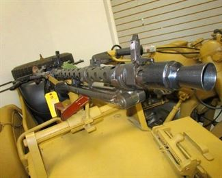 MG-34 with solidly blocked receiver.                                                                                                                                                         MG-34  Specification Type	light or medium machine gun Caliber	7.92mm Length	48.0 in Weight	26 lb 11 oz Barrel	24.75 in long, 4 grooves, right hand twist Feed system	Belt or 75-round saddle drum System of operation	Recoil; revolving bolt head Muzzle velocity	2,475 feet/sec Rate of fire	850 rpm