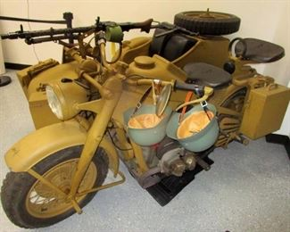 1944 Zundapp KS-750 Motorcycle made for the German Army during WW II.  Only 18,600 were produced and this one which has the matching serial on the side car was the  16,172 one produced. It comes with the original MG-34 machine gun from which the receiver was removed and replaced with solid steel block and is thus a totally legal BATF approved non-firing original genuine WWII machine gun! Otherwise all other parts to this bike and the armament are original and are legal to own. Abandoned by the German Army during the retreat from Russia and found hidden in a barn in Eastern Europe, this relic was brought to this country and restored by the owner and is the only Motorcycle of this type, in this condition, currently for sale in the entire world.                                                                                                                                                                                                                            History of the Zundapp KS-75