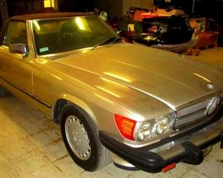 1989 Mercedes 560-SL with only 101,000 miles and in excellent condition. The colors are gold/Brown and it come with a hard top if one wants to remove the convertible top. This car also now qualifies for an antique license plate.