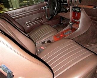 Brown leather interior is without wear or damage