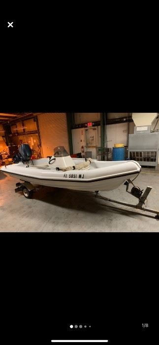 Made by Outboard Marine: Hard shell Avon or Zodiac style boat with Evinrude 40 on trailer.