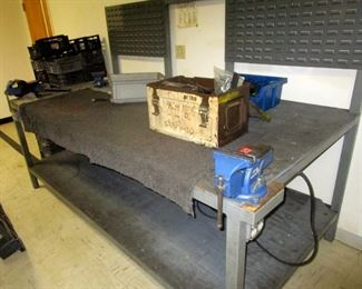 Steel work bench with two mounted vices and back board for hanging bins or tools