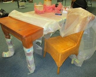 Pine table from Germany. Brand new and solid still in wrappers. Wicker chair