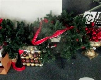 Christmas decorations. Several trees in boxes