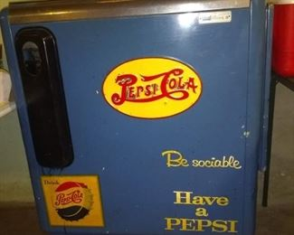 Late 50' early 60's Ideal Pepsi Dispenser Cooler. Cooler works great, but doesn't have the coin op unit or the bottle dispensing rack. Has the spinning locking handle.