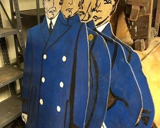 Police cutouts hand made by owner of police uniform shop used to adorn the walls of his shop. 1940s