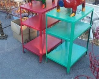 vintage metal rollaway carts with painted metal roosters and piggies.