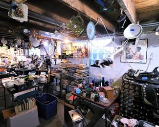 Stacks of antique books, tabletop clocks, lots of glassware... Also featuring a vintage black leather horse saddle with Mexican silver embellishments. Make sure to look UP, there are treasures on the ceiling, too!