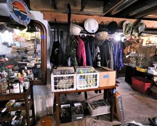 Vintage liquor bottles, vintage clothing for men and women, vintage hats and helmets, bins of vintage music records. There are vintage eyeglasses and music CDs below.
