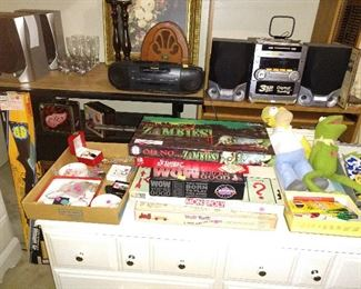 Board Games, Costume Jewelry, Sony Speakers, Vintage Radios, CD/Cassette player, Computer table, vintage wood table.