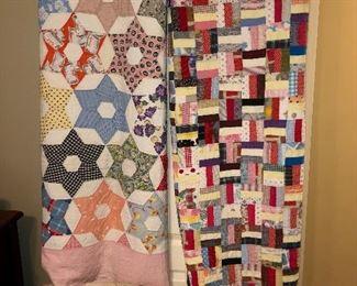 Several antique quilts