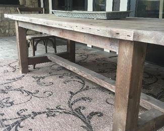 Another view of the table shown with outdoor rug