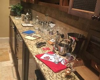 Bar accessories, including glassware, serving pieces, cocktail shakers etc