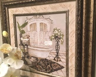 Framed print and faux orchid