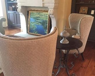 Pair of custom upholstered chairs shown with round side table