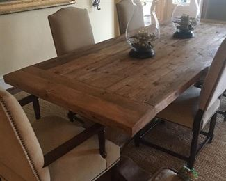 Restoration Hardware dining table shown with eight chairs (six side and two arm) Chairs and table sold separately.  Two leaves extend the table