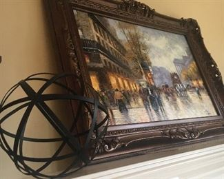 Metal sphere and framed print