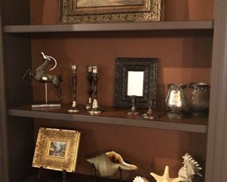 Home decor including mounted shells and shell on stand
