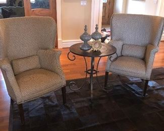 Pair of wing back chairs and round metal side table