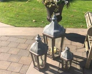 Three outdoor lanterns (sold individually) large urn with fall plantings